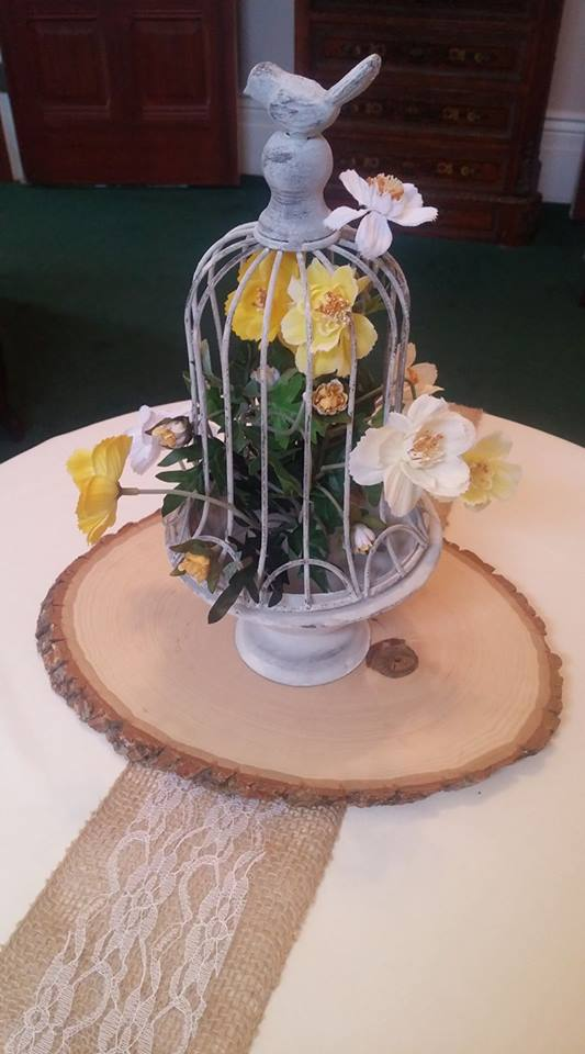 One of our newer centerpiece options, this rustic birdcage will look great with all sorts of flowers.
